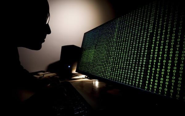 A man looks at a computer screen with a binary code in Warsaw, Poland on February 21, 2021. The US Justice Department announced charges for three North Korean programmers accusing them of conspiring to extort over a billion US dollars from banks and other businesses worldwide. (Photo by Jaap Arriens / Sipa USA)(Sipa via AP Images)