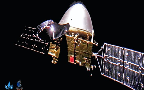 宇宙空間を飛行する中国の無人探査機「天問1号」(新華社=共同)