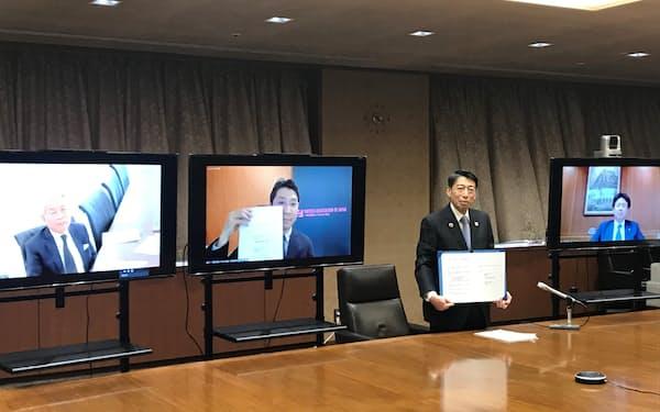 福岡県とフィンテック協会が開いた連携協定の締結式(福岡県庁)