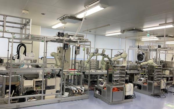 従来の自動化システムで検体の開栓から解析まで3時間半以上かかっていた検査を約80分に短縮できる(神戸市内)=シスメックス提供