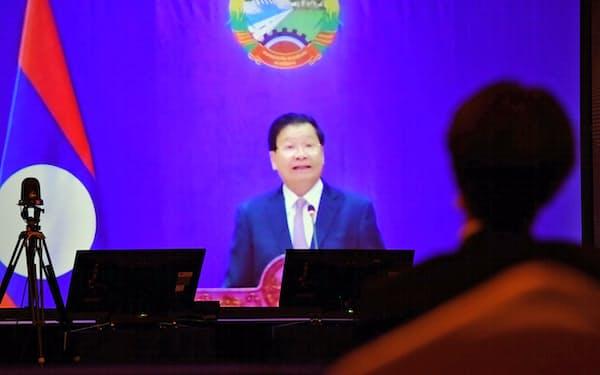 「アジアの未来」で講演するラオスのトンルン国家主席(21日午前、東京都千代田区)