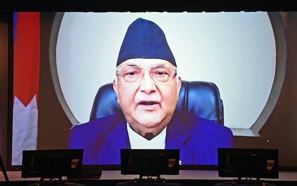 「アジアの未来」で講演するネパールのオリ首相(21日午後、東京都千代田区)
