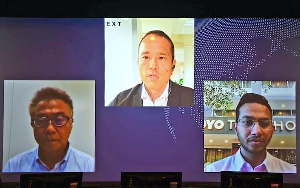 討論する(右から)リテシュ・アガルワルOYOホテルズアンドホームズ創業者兼CEO、佐藤輝英BEENEXTファウンダー・CEO。左はモデレーターの小柳建彦日本経済新聞社編集委員兼論説委員(21日午後)