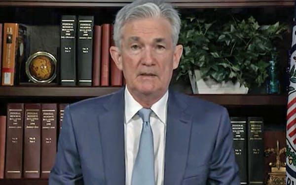 デジタル通貨に関する声明を述べるFRBのパウエル議長=20日、ワシントン(共同)