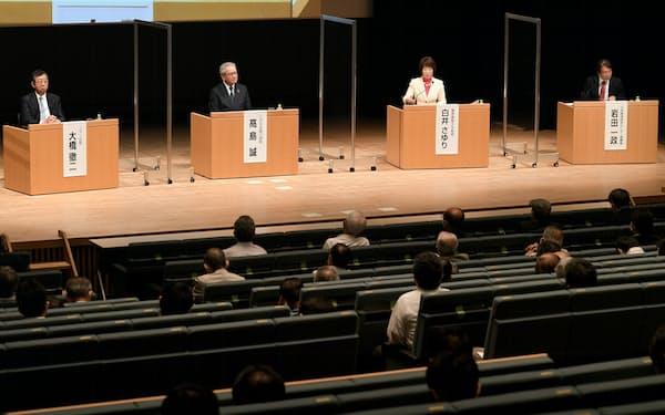 討論する(左から)大橋、高島、白井、岩田の各氏(24日、東京・大手町)