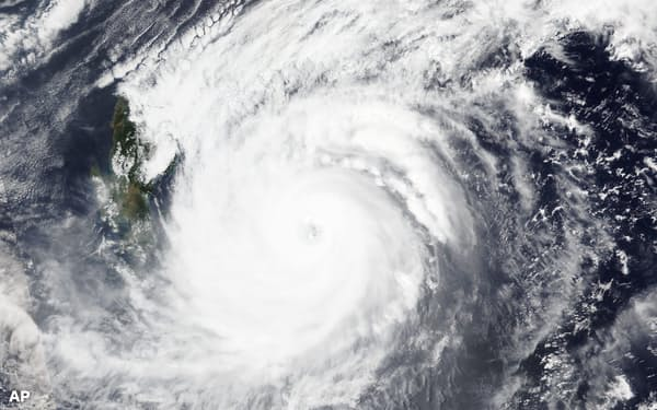 This April, 19, 2021 satellite image released NASA shows typhoon Surigae over Philippines. The approaching typhoon has prompted the evacuation of more than 100,000 people as a precaution in the Philippines, although the unusual summer storm is not expected to blow into land. (NASA Worldview, Earth Observing System Data and Information System (EOSDIS) via AP)