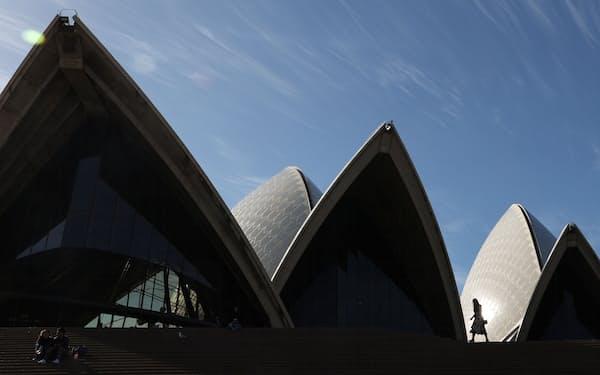 People are seen in front of the Sydney Opera House in Sydney, Australia, May 25, 2021.  REUTERS/Loren Elliott