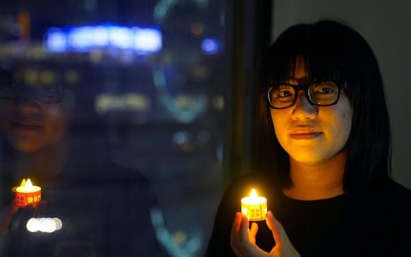 4日、香港の民主派団体幹部の鄒幸彤氏が逮捕された=ロイター