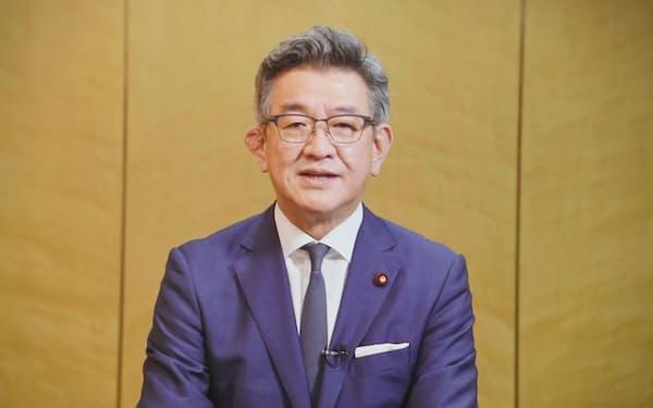 「世界デジタルサミット2021」であいさつする武田良太総務相(7日午前、東京・大手町)