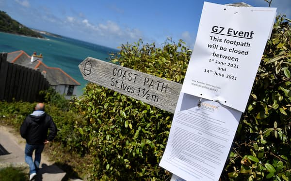 A sign notifying of an upcoming security closure of the coastal path near Carbis Bay resort, where an in-person G7 summit of global leaders is due to take place in June, St Ives, Cornwall, southwest Britain May 24, 2021. Picture taken May 24, 2021. REUTERS/Toby Melville