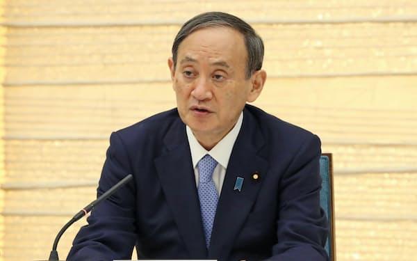 経済財政諮問会議であいさつする菅首相(9日、首相官邸)
