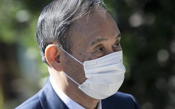 菅首相はサミットで連日中国に言及した(12日)=AP