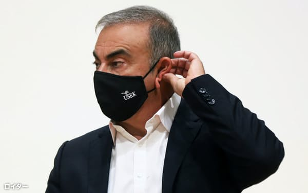 Carlos Ghosn, the former Nissan and Renault chief executive, adjusts his protective face mask during a news conference at the Holy Spirit University of Kaslik, in Jounieh, Lebanon September 29, 2020. REUTERS/Mohamed Azakir