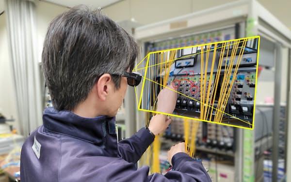 KDDIは自社が販売するスマートグラスを遠隔作業支援システムに投入した=KDDI総合研究所