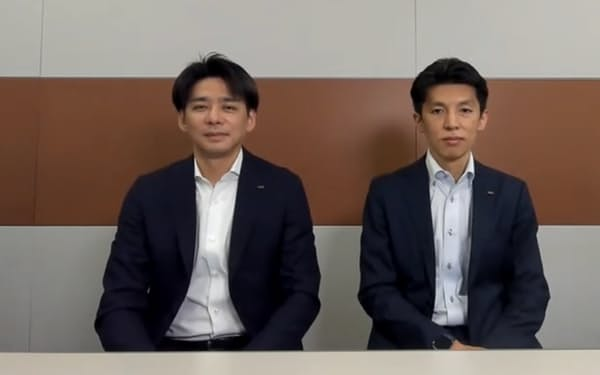 KDDIパーソナル事業本部の長谷川渡氏(左)と村元伸弥氏(右)
