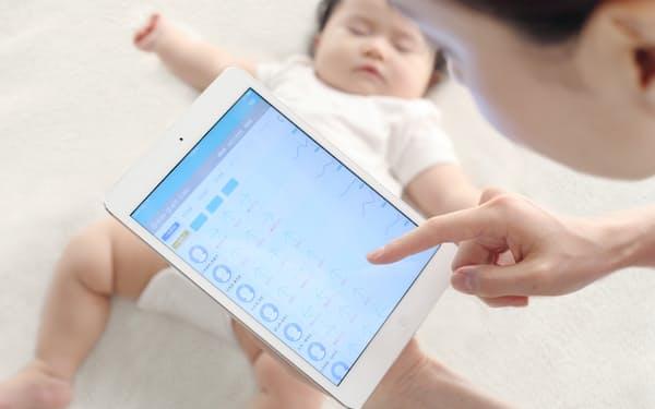 昼寝中の子供をデジタル技術で見守り