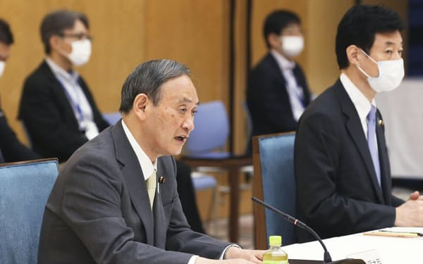 菅義偉首相=18日(共同)