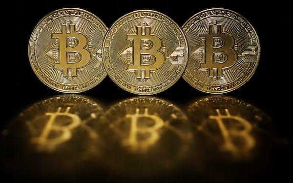 代表的な暗号資産であるビットコイン=ロイター