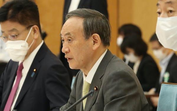 経済財政諮問会議と成長戦略会議の合同会議であいさつする菅首相(6月18日、首相官邸)