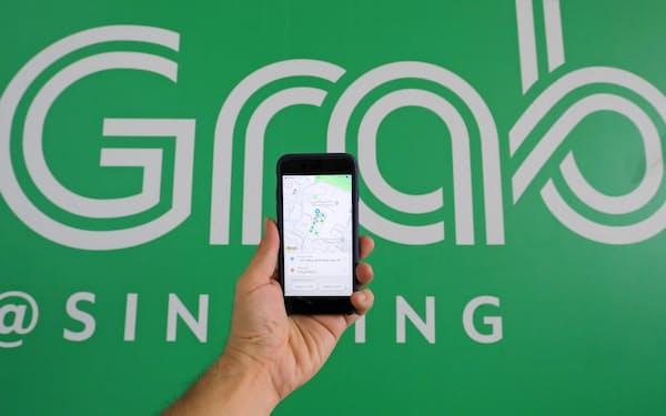 2012年の創業以来、シンガポールのグラブはタクシー配車から16年に立ち上げた電子決済まで事業の多角化を推進してきた=小林健撮影