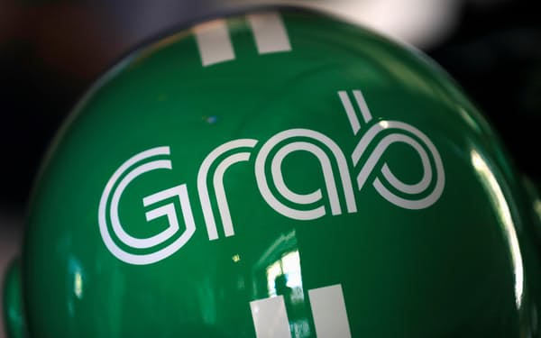 グラブは創業の地のマレーシアで銀行免許の取得を狙う=ロイター