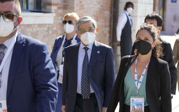 Haruhiko Kuroda, Governor of the Bank of Japan, center, arrives for a G20 meeting of Economy and Finance ministers and Central bank governors, in Venice, Italy, Friday, July 9, 2021.  (AP Photo/Luca Bruno)