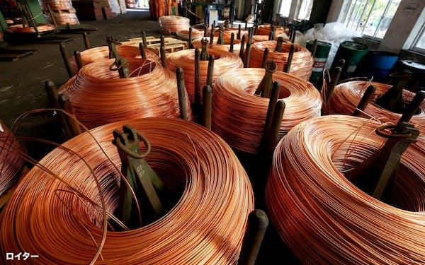 銅はEVや再生エネルギーインフラの導電材料として使う=ロイター
