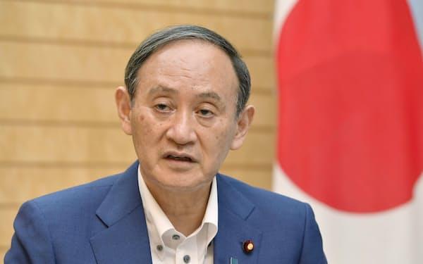 菅義偉首相=共同