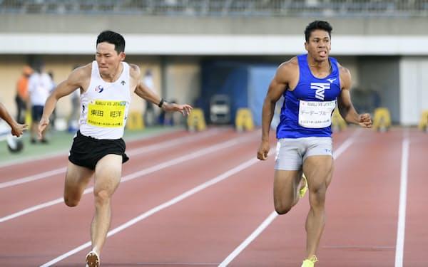 男子100メートル 10秒28で2位だったデーデー・ブルーノ。左は優勝した東田旺洋(17日、レモンガススタジアム平塚)=共同
