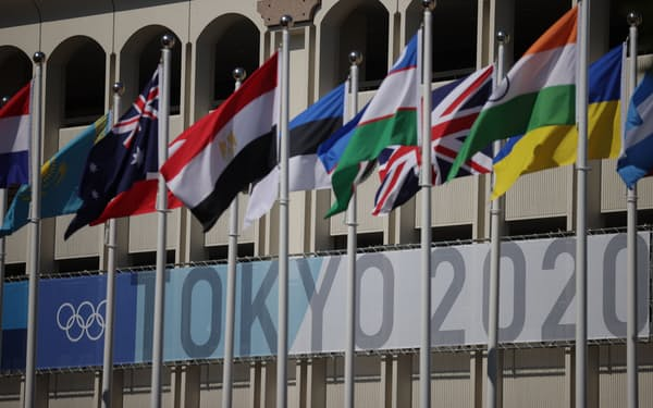 Tokyo 2020 Olympics - Tennis Training - Ariake Tennis Park, Tokyo, Japan - July 19, 2021 Tokyo 2020 Olympics signage is seen behind nations flags at the Ariake Tennis Park REUTERS/Hannah Mckay