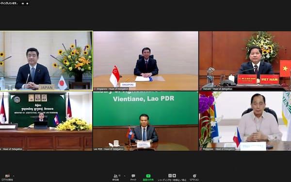 野上農相(左上)が各国代表らとテレビ会議形式で会談した(19日)