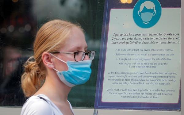米国でマスク着用ルールの方針転換を巡り、混乱が広がっている=ロイター