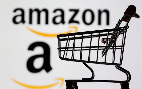 Small toy shopping cart is seen in front of displayed Amazon logo in this illustration taken, July 30, 2021. REUTERS/Dado Ruvic/Illustration