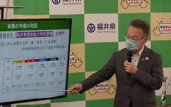 福井県の杉本達治知事は「県外由来の新規感染が増えた」と説明した(3日、福井県庁)
