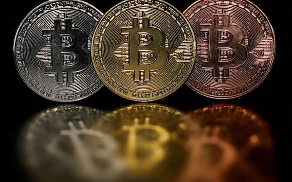新上場するETFのビットコインとの価格連動性は、最大90%に上るという=ロイター