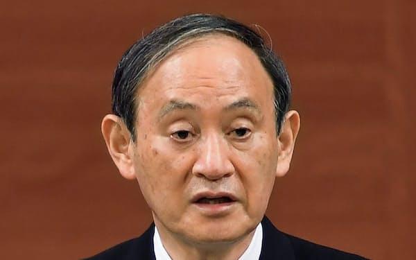 記者会見する菅首相=6日午前、広島市(代表撮影)