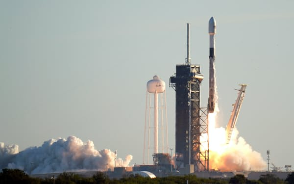 A Falcon 9 SpaceX rocket lifts off from pad 39A at the Kennedy Space Center in Cape Canaveral, Fla., Wednesday, Jan. 20, 2021. The payload is the 17th batch of approximately 60 satellites for SpaceX's Starlink broadband network. (AP Photo/John Raoux)