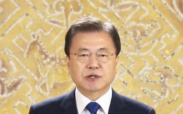 韓国政府主催の「日本軍慰安婦被害者をたたえる日」の式典に寄せられた文在寅大統領の映像メッセージ=14日(共同)