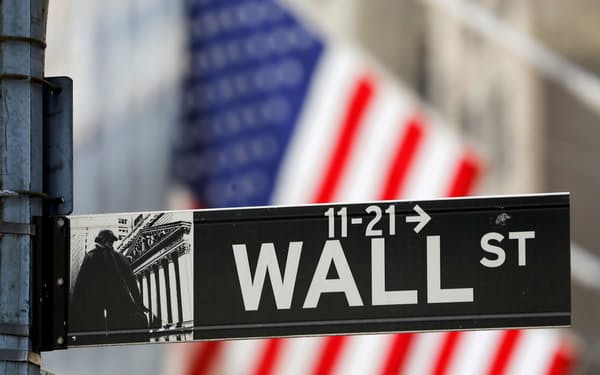 FILE PHOTO: A street sign for Wall Street is seen outside the New York Stock Exchange (NYSE) in New York City, New York, U.S., July 19, 2021. REUTERS/Andrew Kelly/File Photo
