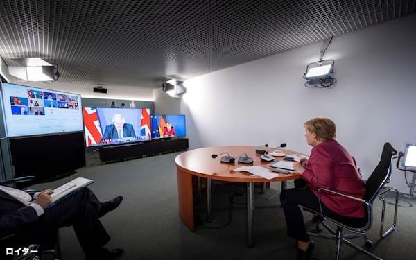 G7首脳会議に臨むメルケル独首相(24日、ベルリン)=ロイター