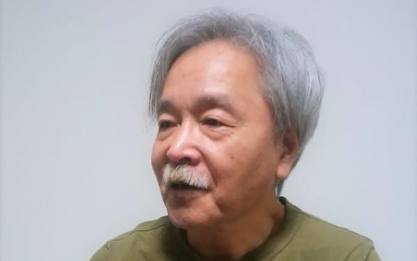 「現実社会の全体像を描くことを目指した」と語る竹本健治