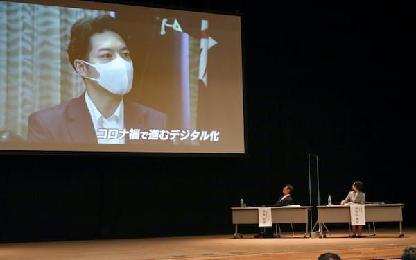 日経の北海道印刷50周年のシンポジウムでは北海道の鈴木直道知事がビデオメッセージを寄せた(27日、札幌市)