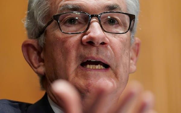 米金融市場は「利上げを急がない」と受け止め、株高と金利低下が進んだ=ロイター