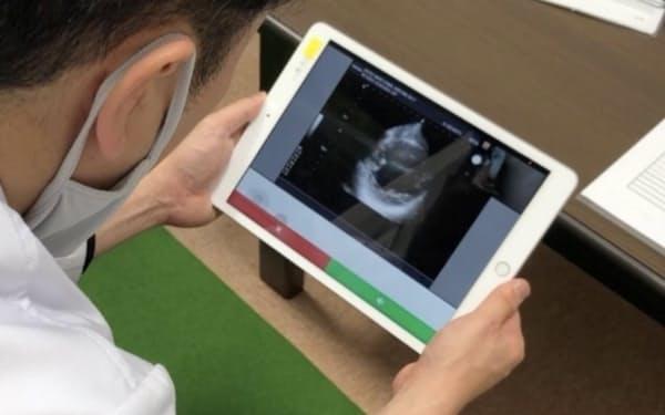 患者の心電図などをリアルタイムに見ながら遠隔地の医師が助言できる