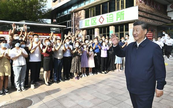 習近平国家主席(右)=新華社=共同