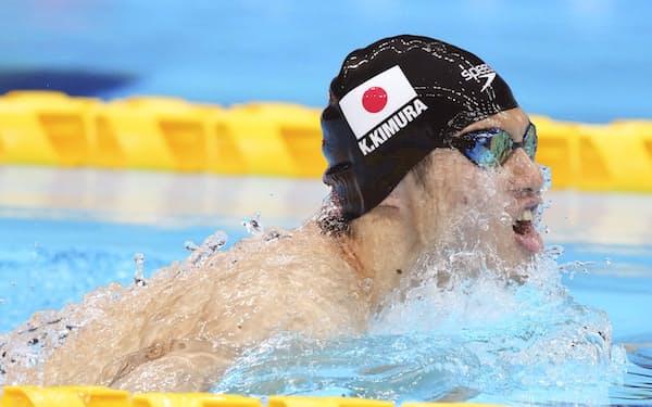 男子100メートル平泳ぎ(視覚障害SB11)予選で力泳する木村敬一=共同