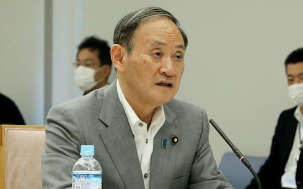 菅首相(6日、首相官邸)