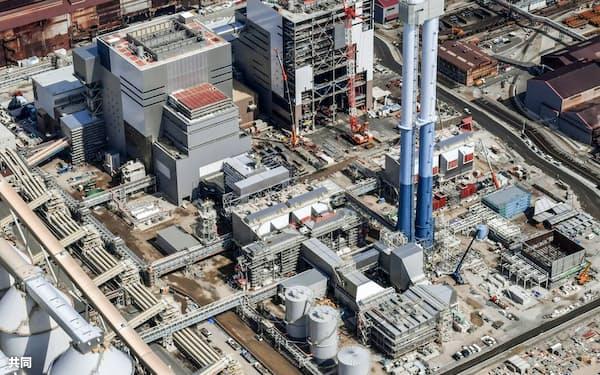 企業の排出量の公表制度を充実させる(写真は建設計画中の石炭火力発電所)=共同