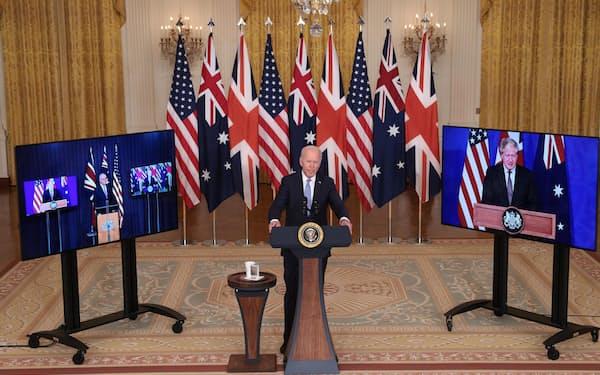 米英豪3カ国は中国をにらみ、新たな安保協力の枠組みづくりで合意した=15日(ゲッティ=共同)