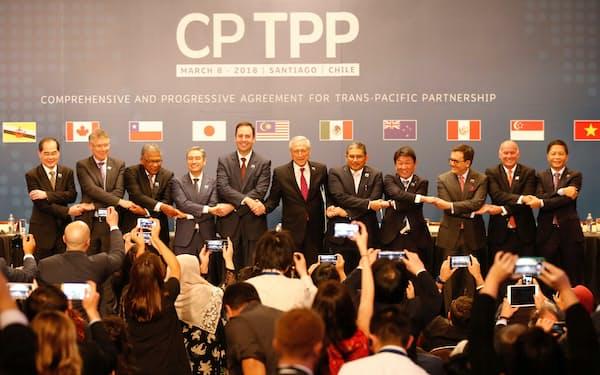 TPPにはASEANからシンガポール、マレーシア、ベトナム、ブルネイの4カ国が参加する(写真は2018年3月にチリで開かれた署名式)=ロイター